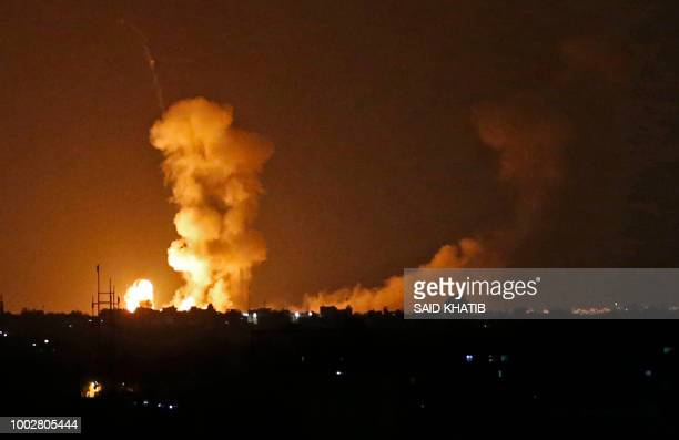 Picture taken on July 20, 2018 shows explosions from Israeli bombardment in Khan Yunis in the southern Gaza Strip. - Israeli aircraft and tanks hit...
