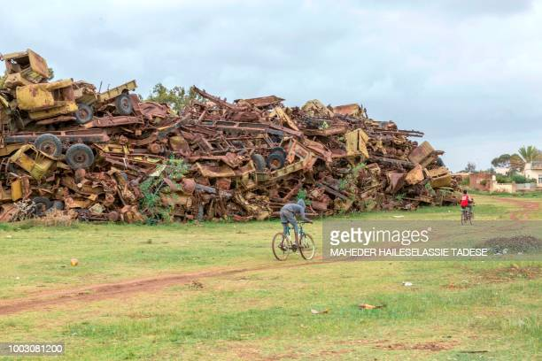 A picture taken on July 20 2018 shows military tanks and trucks destroyed in the EritreaEthiopia border war piled as a monument in the Eritrean...