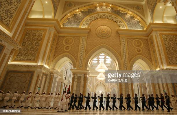 TOPSHOT A picture taken on July 20 2018 shows the presidential palace in Abu Dhabi during the Chinese President Xi Jinping's visit to the UAE capital...