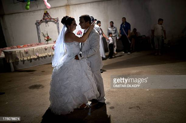 A picture taken on July 20 shows a newlywed Roma couple dancing during their wedding party in the village of Dolni Tsibar on the river Danube The...