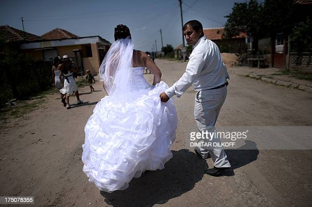 A picture taken on July 20 shows a newlywed Roma couple walking in the village of Dolni Tsibar on the river Danube The European Commission has called...