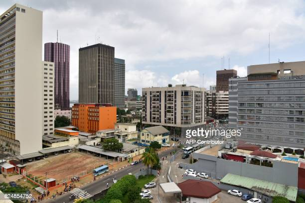 A picture taken on July 21 2017 shows a view of Le Plateau the business district of the Ivorian capital Abidjan / AFP PHOTO / ISSOUF SANOGO