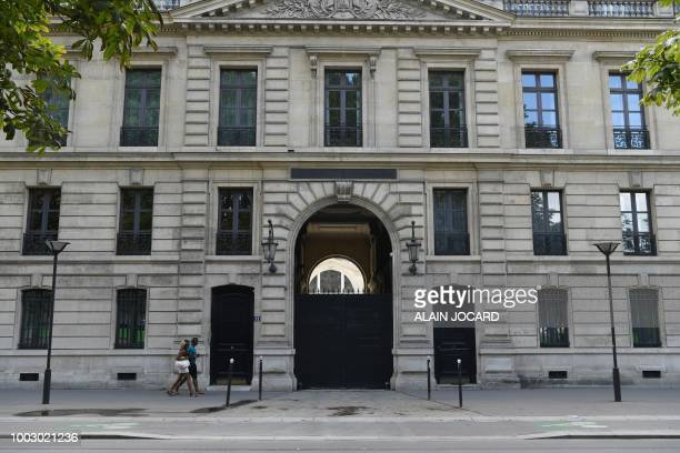 A picture taken on July 21 2018 shows people walking in front of a building belonging to the Elysee Palace at 11 Quai Branly in Paris housing...
