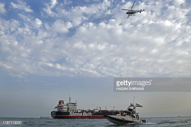 TOPSHOT A picture taken on July 21 shows Iranian Revolutionary Guards patrolling around the Britishflagged tanker Stena Impero as it's anchored off...