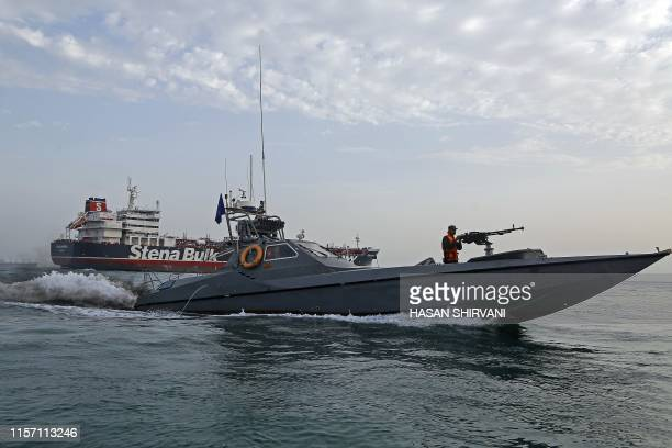 A picture taken on July 21 shows Iranian Revolutionary Guards patrolling around the Britishflagged tanker Stena Impero as it's anchored off the...