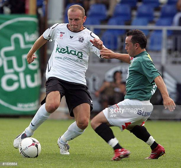 A picture taken on July 22 2007 shows SK Austria Polish player Adam Ledwon fighting for the ball with SV Ried player Erbek Harun during an Austrian...