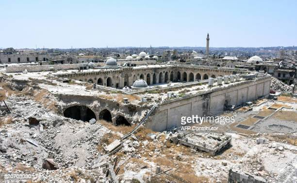 TOPSHOT A picture taken on July 22 2017 in the northern Syrian city of Aleppo which was recaptured by government forces in December 2016 shows a...