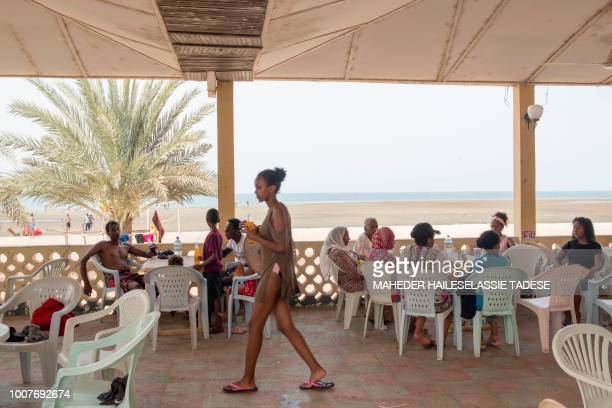 A picture taken on July 22 2018 shows local and visitors at a hotel by the beach in Massawa 60km of the Eritrean capital Asmara Eritrea's dormant...
