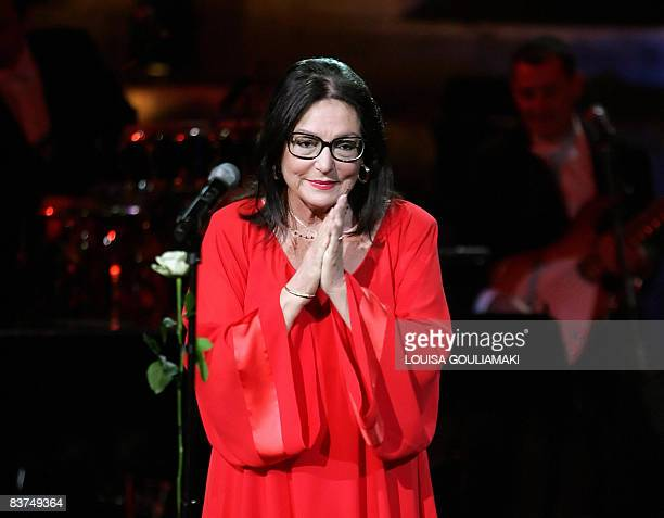 Picture taken on July 23, 2008 shows Greek singer Nana Mouskouri performing in a tribute concert at the ancient Herodus Atticus theatre at the foot...