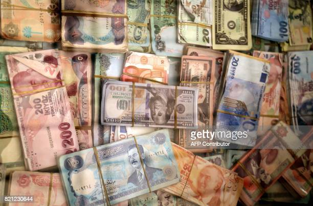 A picture taken on July 23 2017 shows a close up of a pile of money notes at a currency exchange point in Arbil the capital of the autonomous Kurdish...
