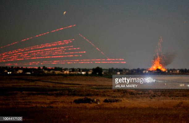 A picture taken on July 23 2018 from the Israeliannexed Golan Heights shows an explosion caused by air strikes backing a Syriangovernmentled...