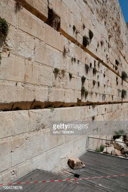 A picture taken on July 23 2018 shows the massive stone block that dislodged from the Western Wall Judaism's holiest worship site falling down onto...