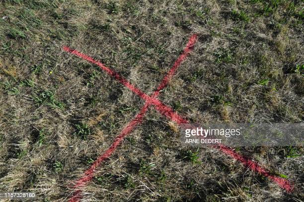 Picture taken on July 23 2019 shows marks on a grass strip in Biebergemuend near Bad Orb western Germany where a German man the suspected aggressor...