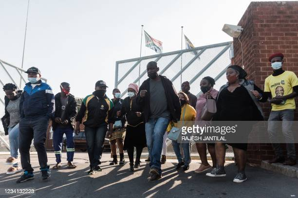Picture taken on July 23, 2021 shows members of the African National Congress protest at the Phoenix Police station in Phoenix, north of Durban to...
