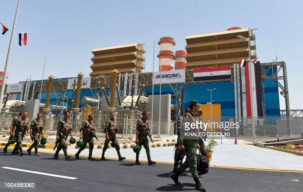 A picture taken on July 24 2018 shows Egyptian soldiers in front of a newly constructed combinedcycle power stations on the outskirts of the capital...