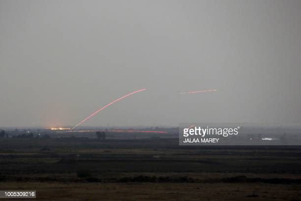 A picture taken on July 25 2018 from the Tal Saki hill in the Israeliannexed Golan Heights shows tracer fire from antiaircraft guns fired by Syrian...