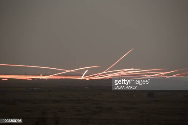 TOPSHOT A picture taken on July 25 2018 from the Tal Saki hill in the Israeliannexed Golan Heights shows tracer fire from antiaircraft guns fired by...
