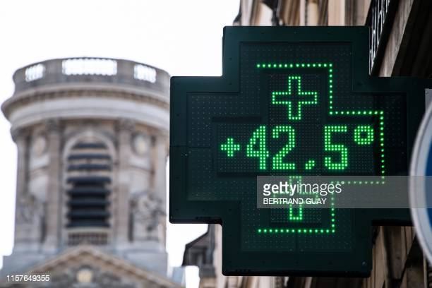 A picture taken on July 25 2019 shows a pharmacy thermometer displaying a temperature of 425 degrees Celsius in Paris as a new heatwave hits the...
