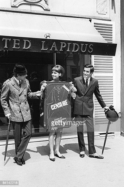 Picture taken on July 25 shows models of French fashion designer Ted Lapidus in front of his Paris. Ted Lapidus, Russian-born whose career soared in...