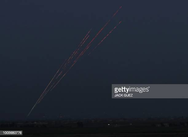 TOPSHOT A picture taken on July 26 2018 from fields near the Ein Zivan settlement in the Israeliannexed Golan Heights shows tracer fire from...