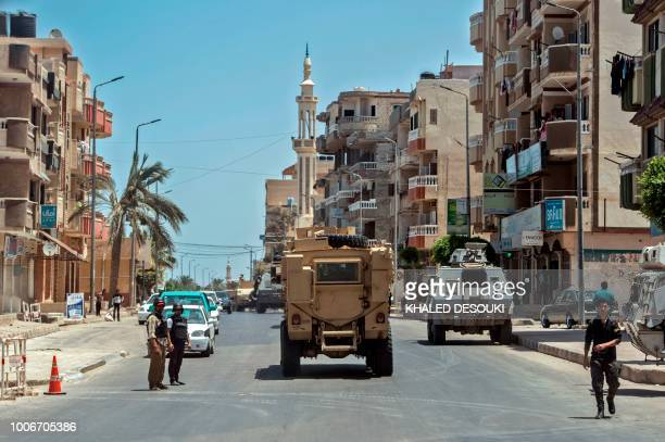 A picture taken on July 26 2018 shows Egyptian policemen driving on a road leading to the North Sinai provincial capital of ElArish With fruit and...