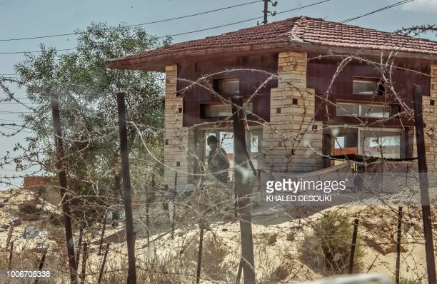 A picture taken on July 26 2018 shows Egyptian policemen stand guarding a checkpoint on a road leading to the North Sinai provincial capital of...