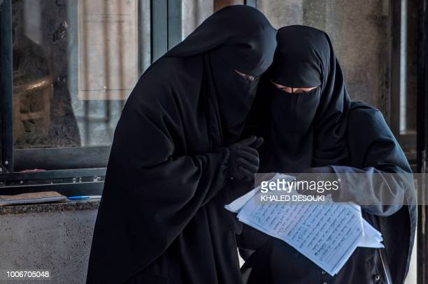Picture taken on July 26 during an army-organised tour, shows Egyptian students reviewing study notes at the university of el-Arish in the northern...