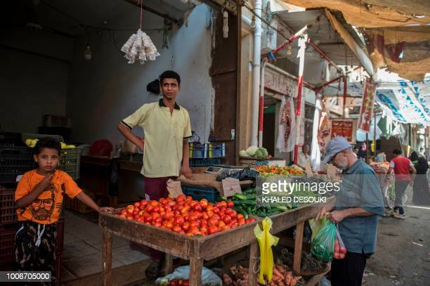 Picture taken on July 26 during an army-organised tour, shows Egyptians at a public market in el-Arish city in the northern Sinai Peninsula. - With...