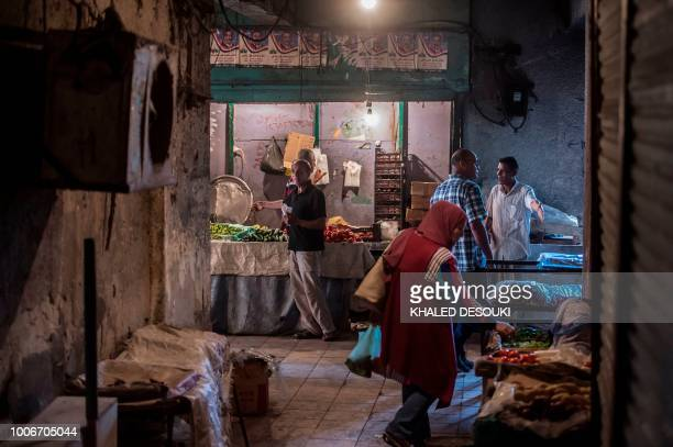 Picture taken on July 26 during an army-organised tour, shows Egyptians at the public market in el-Arish city in the northern Sinai Peninsula. - With...