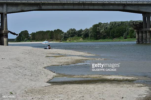 A picture taken on July 26 near Boretto shows the Po river that flows 652 kilometers eastward across northern Italy from Monviso in the Cottian Alps...