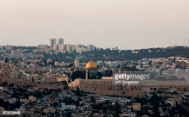 A picture taken on July 27 2017 shows a general view of Jerusalem's Old City skyline from the west with the Golden Dome of the Rock seen in the...