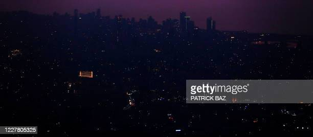 Picture taken on July 27, 2020 shows part of Lebanons capital Beirut in the dark caused by fuel shortages. - Lebanon is grappling with its worst...