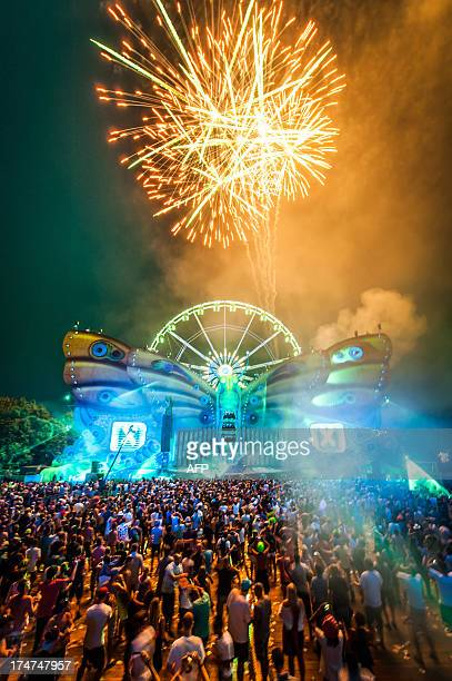 A picture taken on July 28 2013 shows fireworks over a light show during the third day of the 9th edition of the Tomorrowland music festival in Boom