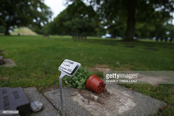 A picture taken on July 28 2015 shows a sign indicating the grave of German SS officer Michael Wittmann at the German war cemetery in La Cambe...