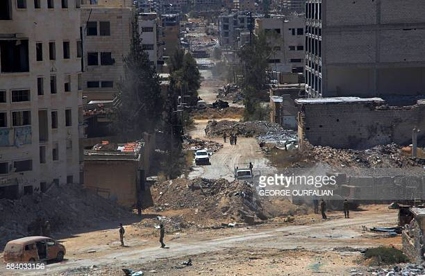 A picture taken on July 28 2016 shows a general view of the entrance of Bani Zeid after Syrian progovernment forces took control of the previously...