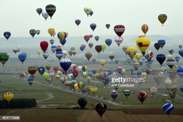 Picture taken on July 28, 2017 shows an aerial view of hot air-balloons at Chambley-Bussieres airbase, near Hageville, eastern France, before the...