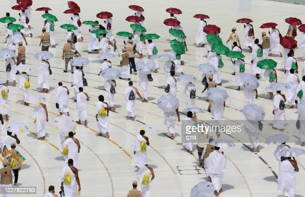 A picture taken on July 29 2020 shows pilgrims some holding coloured umbrellas along matching coloured rings separating them as a COVID19 coronavirus...