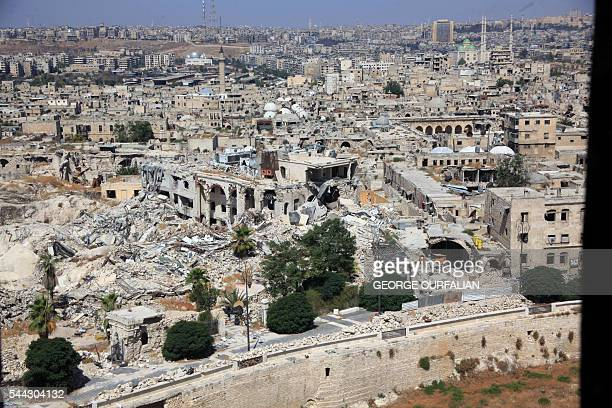 A picture taken on July 3 2016 from the UNESCOlisted citadel shows collapsed and damaged buildings including the famed Carlton Citadel Hotel in the...