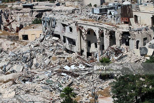 TOPSHOT A picture taken on July 3 2016 from the UNESCOlisted citadel shows the partially collapsed building of the famed Carlton Citadel Hotel in the...