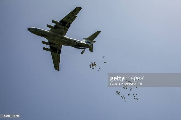 A picture taken on July 3 shows a World Food Programme plane dropping sacks of maize and sorghum in Jeich village in Ayod County northern South Sudan...