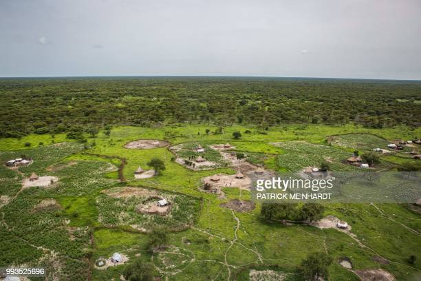 TOPSHOT A picture taken on July 3 shows the village where a World Food Programme plane drops sacks of maize and sorghum in Jeich village in Ayod...