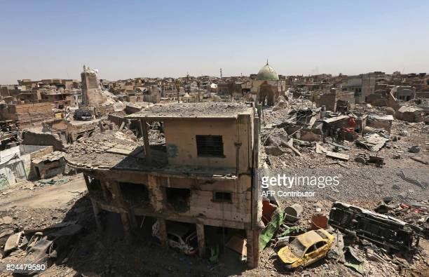 A picture taken on July 30 2017 shows damaged buildings in the old city in west Mosul With Mosul in ruins and nearly a million displaced Iraq now...