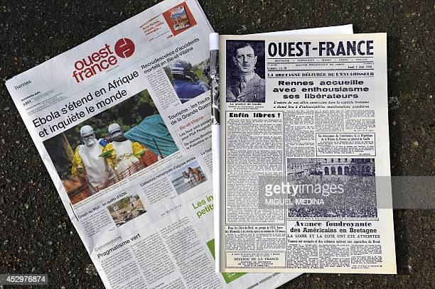 A picture taken on July 31 2014 shows today's front page of OuestFrance next to the first issue of the newspaper published on August 7 1944 French...