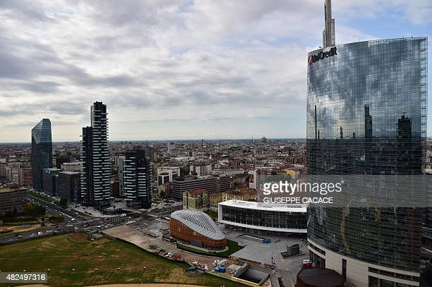 A picture taken on July 31 2015 shows towers builded by Hines as part of the Residenze Porta Nuova area in Milan The towers contain landscaping with...