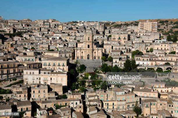 A picture taken on July 31 2017 shows the Cathedral of San Giorgio in Modica Sicily Modica is part of the Italy's UNESCO Heritage Sites / AFP PHOTO /...