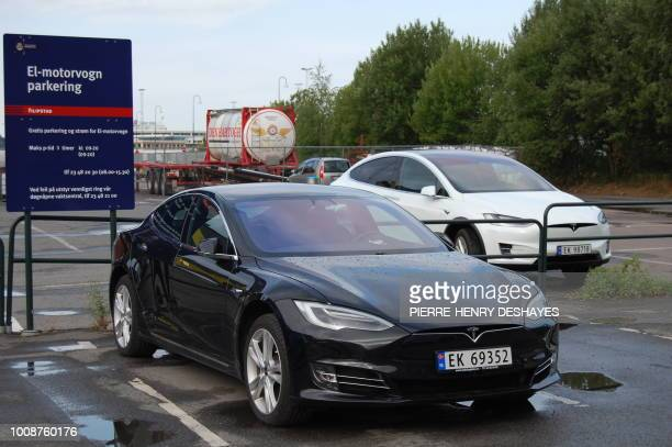 A picture taken on July 31 2018 shows a Model S and Model X electric cars of US car maker Tesla parked on a parking in Oslo Norway In the first half...