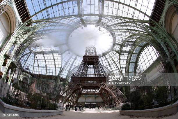Picture taken on July 4, 2017 shows a replica of the Eiffel Tower as part of the set for the Chanel 2017-2018 fall/winter Haute Couture collection in...