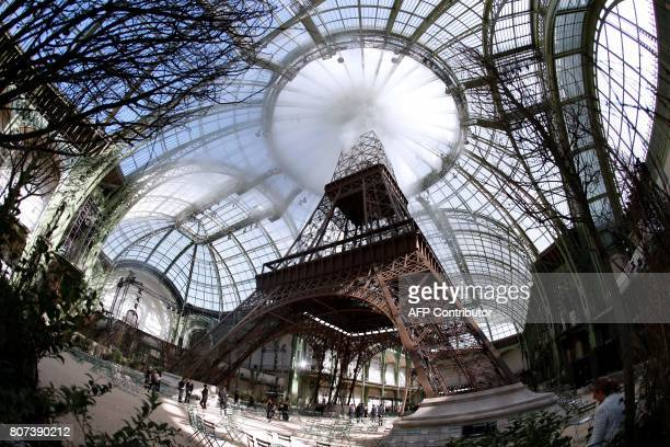 TOPSHOT A picture taken on July 4 2017 shows a replica of the Eiffel Tower as part of the set for the Chanel 20172018 fall/winter Haute Couture...