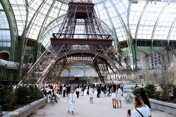 A picture taken on July 4 2017 shows a replica of the Eiffel Tower as part of the set for the Chanel 20172018 fall/winter Haute Couture collection in...