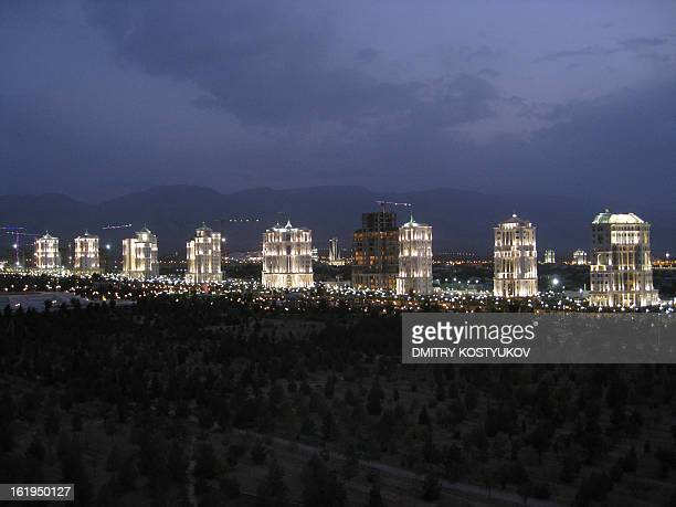 Picture taken on July 5 2008 shows a row of whitemarble Turkmen apartment buildings litup at night in Ashgabat Ashgabat contains numerous whitemarble...